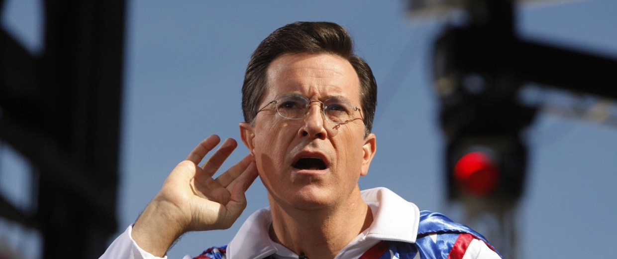 "Image: File photo of Comedian Stephen Colbert gestures during the ""Rally to Restore Sanity and/or Fear"" on the National Mall in Washington"