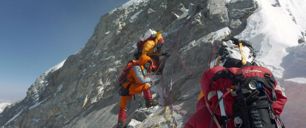 Image: Mountaineers walk past the Hillary Step while pushing for the summit of Everest from the south face of Nepal