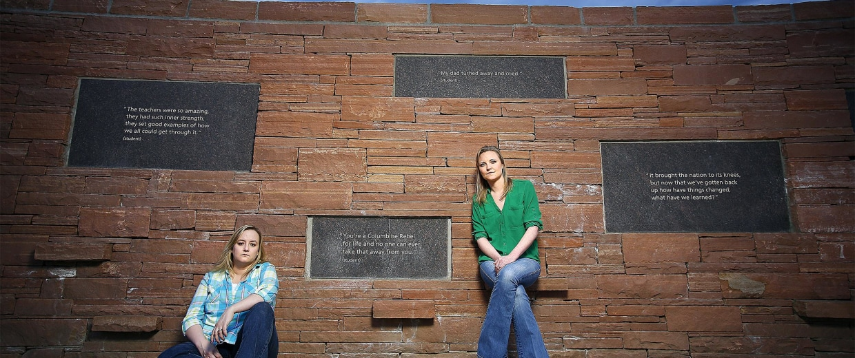 Image: Former Columbine High School students Jennifer Hammer, left, and Heather Egeland pose for a portrait at the Columbine Memorial