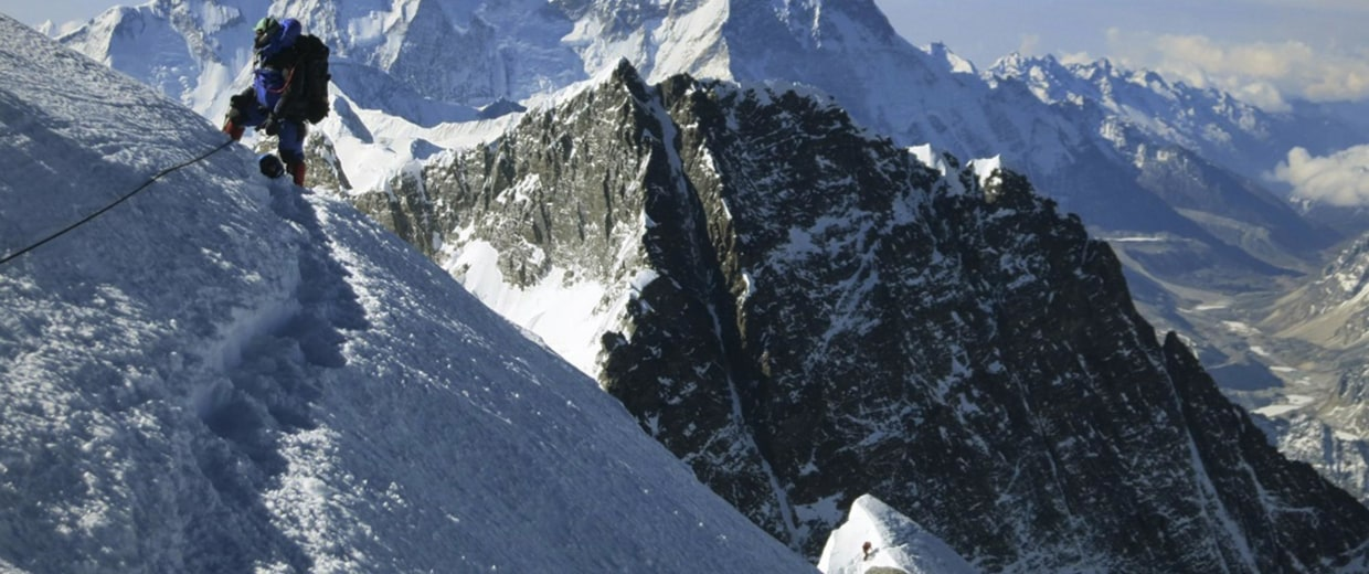 Image: A climber pauses on the way to the summit of Mount Everest