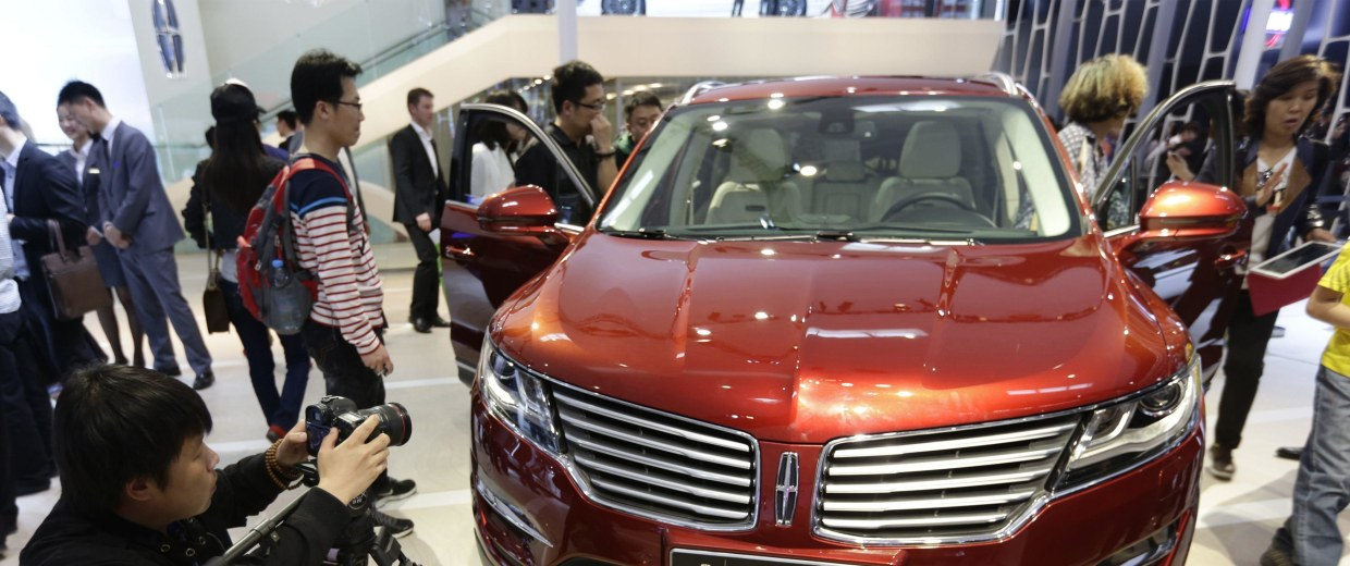 Visitors look at a Lincoln MKX car at Auto China 2014 in Beijing
