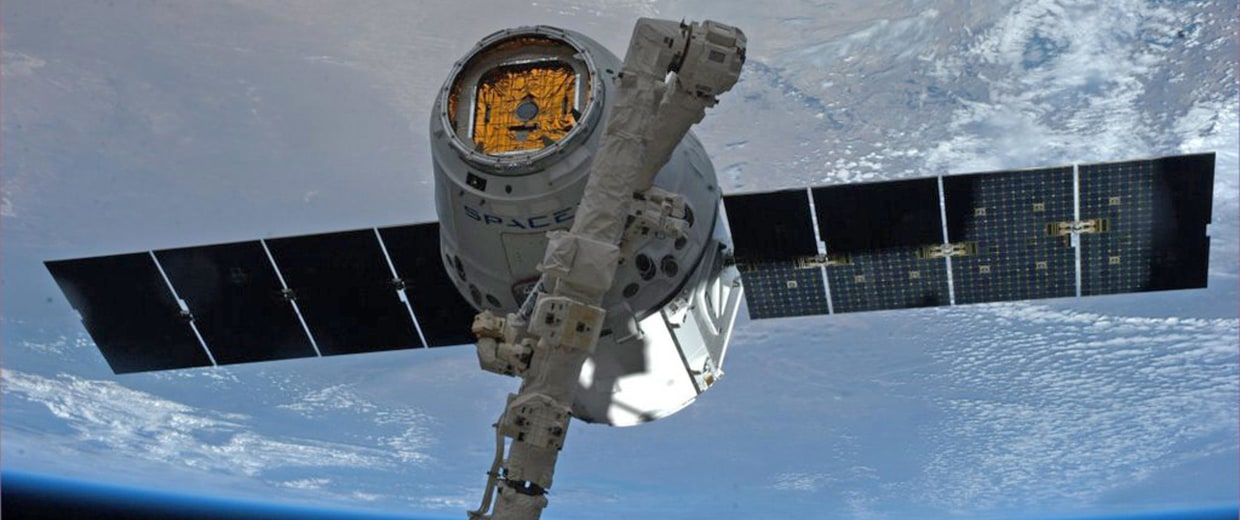 Image: NASA picture of the SpaceX Dragon commercial cargo spacecraft grappled to Canadarm2 at the International Space Station