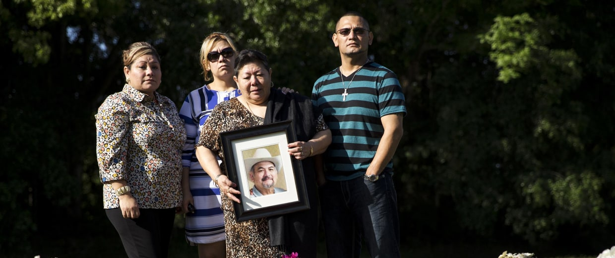 Image: The family of Guillermo Ramirez visits his graveside on April 13, 2014, in Tampa, Fla.
