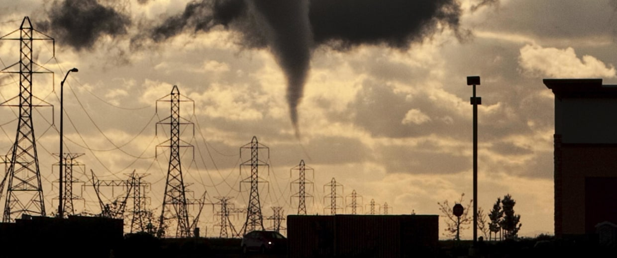 Image: A tornado funnel approaches a r