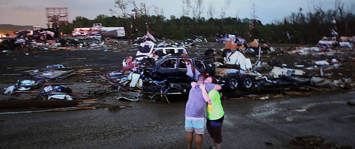 Image: Lori Berseth is consoled after searching for her missing Black Labrador dog after a tornado destroyed the town of Mayflower