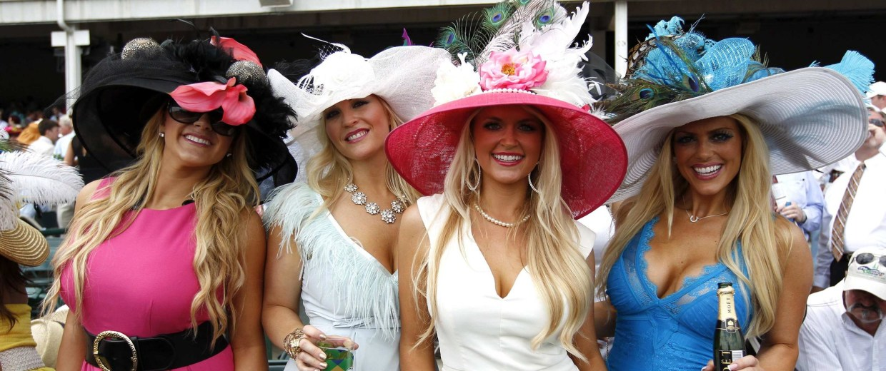 Image: Women wear fancy hats before the Kentucky Derby at Churchill Downs in Louisville