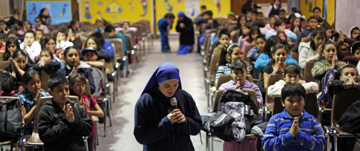 Sister Maria Parousia leads students during a religious studies class at Saint Gabriel of the Sorrowful Mother church in Avondale, Pa.