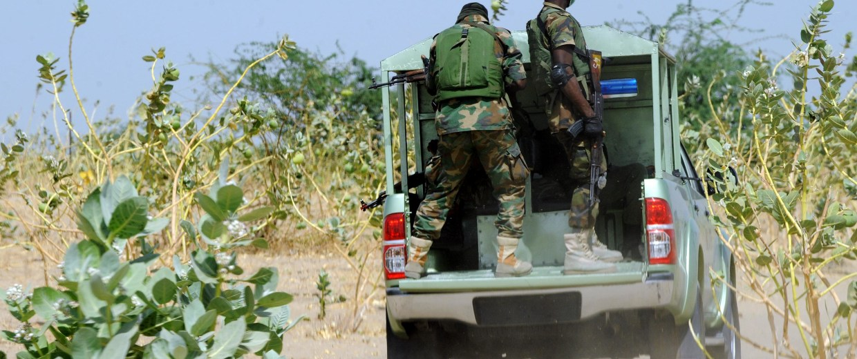 Members of the Joint Military Task Force (JTF) patrol in the northeastern Nigerian town of Maiduguri, Borno State