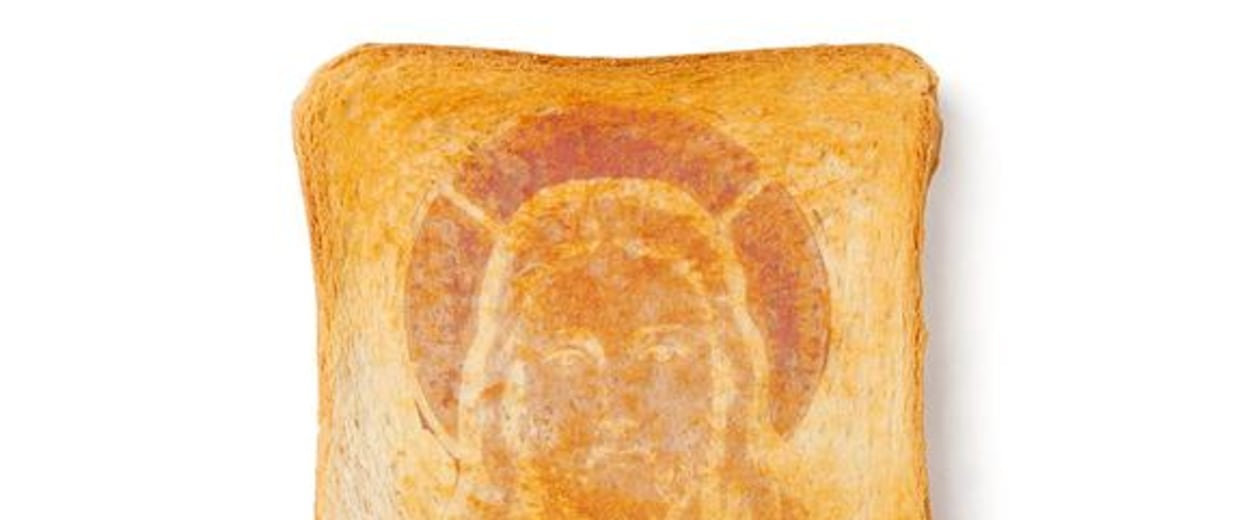 Jesus in a slice of toast? This image may be doctored, but plenty of people claim to see holy faces in burnt bread. The phenonemon of seeing faces in random patterns is called face pareidolia.