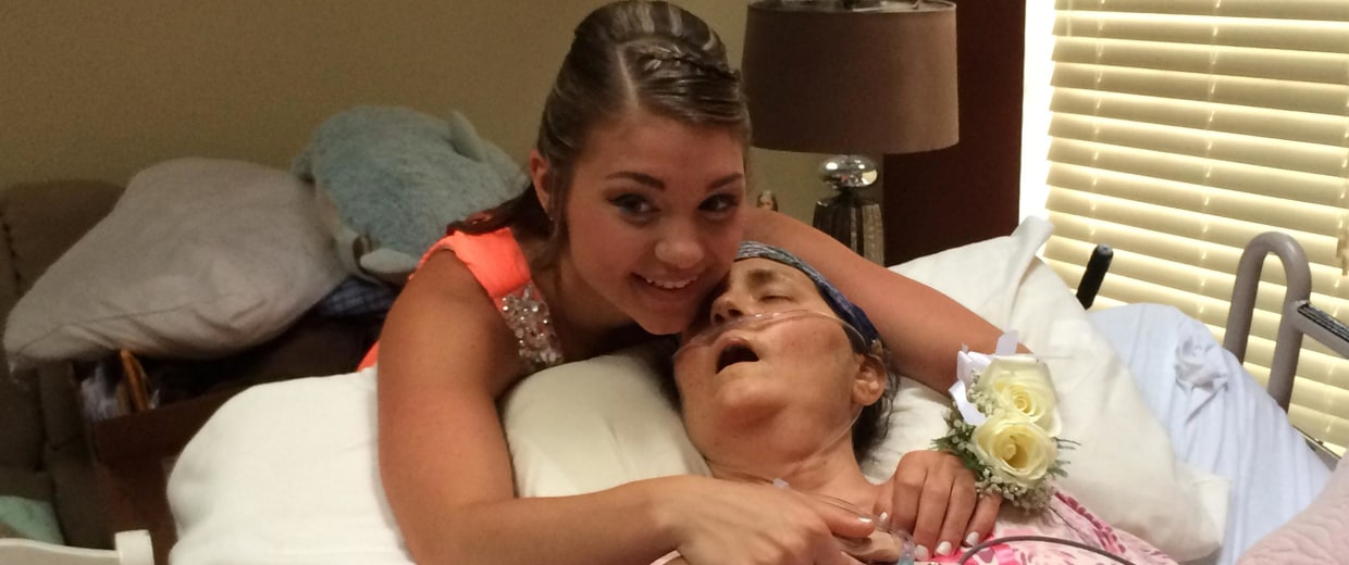 Image: Megan Sugg hugs her cancer-stricken mother, Darlene Sugg on Friday before her prom.