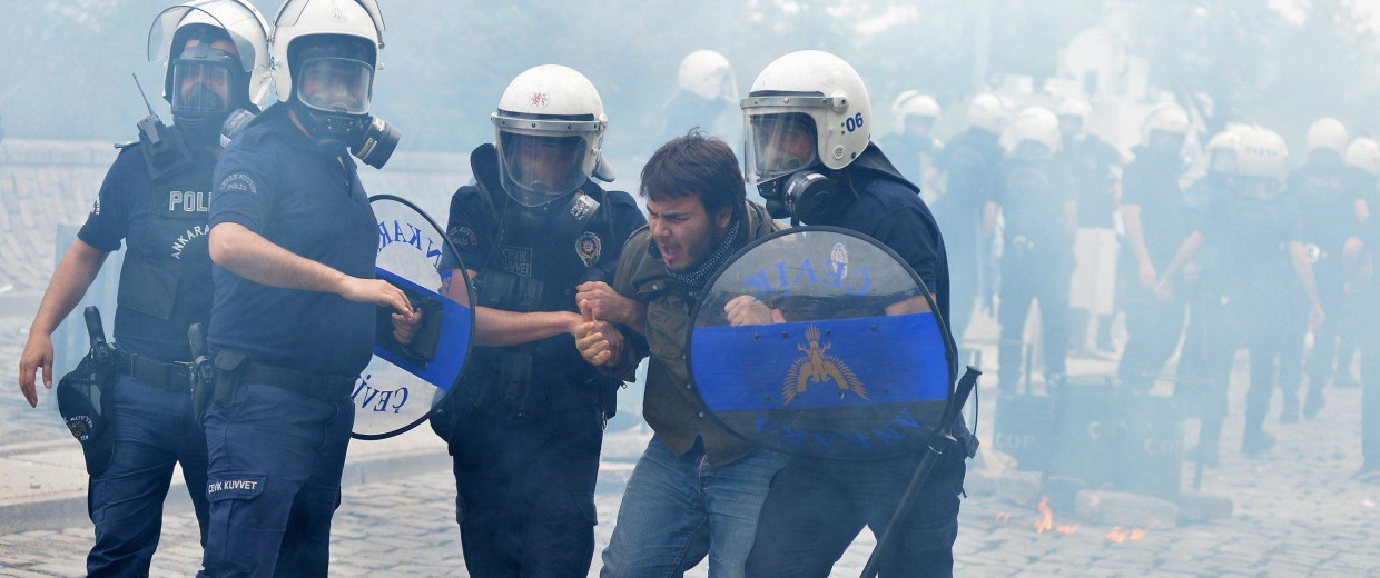 Image: Riot police detain a protester as he and others demonstrate to blame the ruling AK Party (AKP) government on the mining disaster in western Turkey, in Ankara