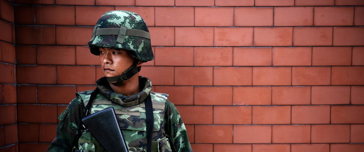 Image: A Thai soldier stands outside the Government Public Relations Department after martial law was imposed in Bangkok