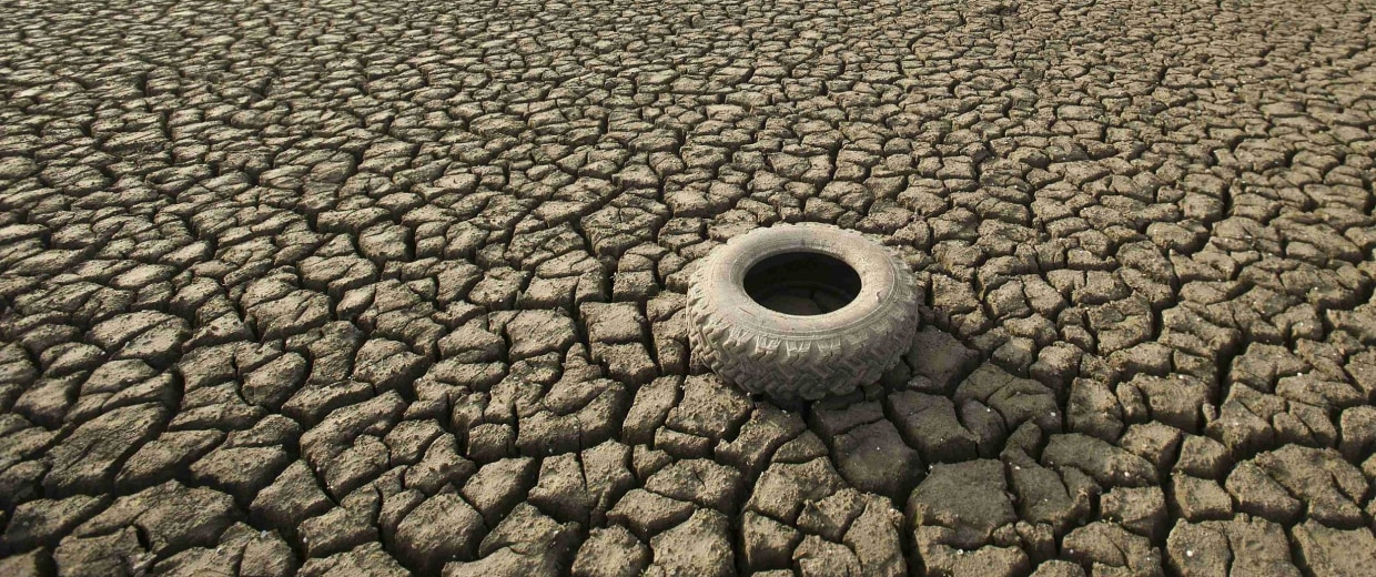 A tire rests on the dry bed of Lake Mendocino, a key Mendocino County reservoir, in Ukiah, California.