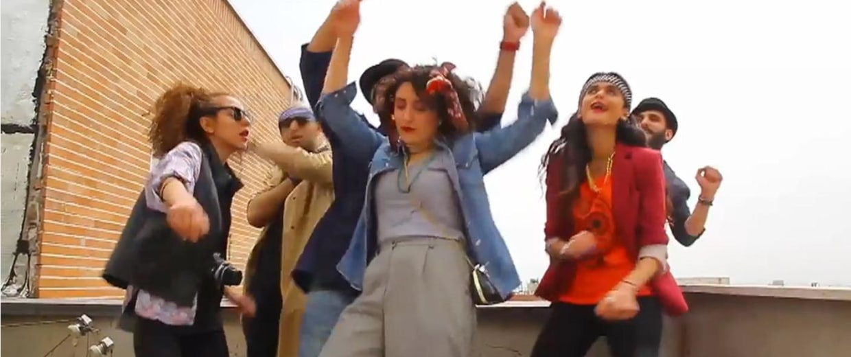 """Imnage: A group of young Iranians was arrested after posting a homemade video set Pharell's his world-famous song """"Happy."""""""
