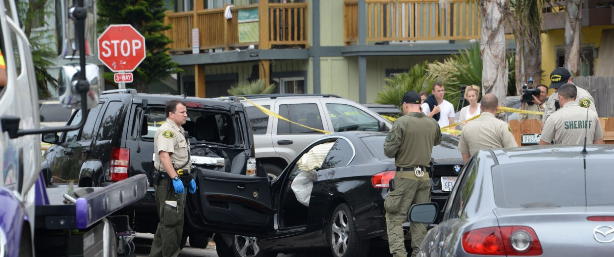 Image: Investigators inspect the suspected gunman's car
