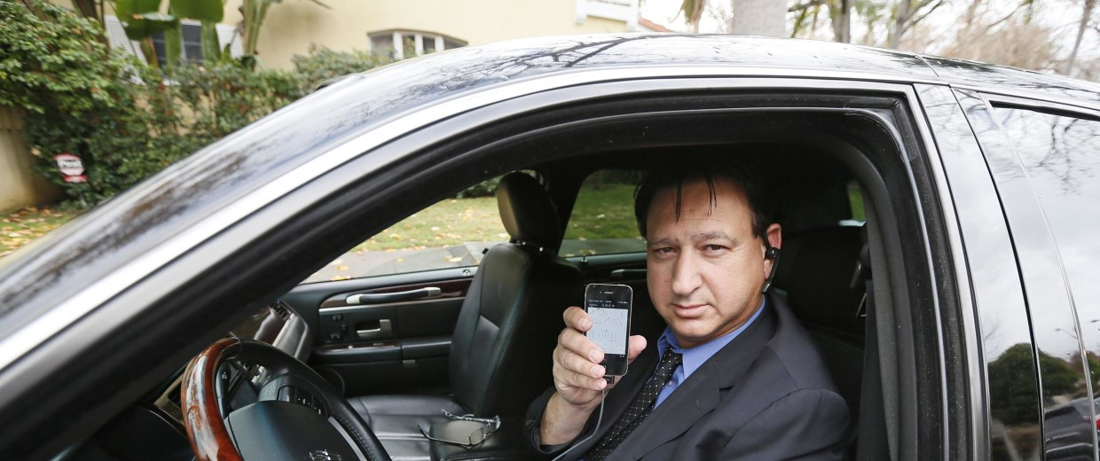 Transportation app Uber driver Shuki Zanna waits for customers in his limousine in Beverly Hills