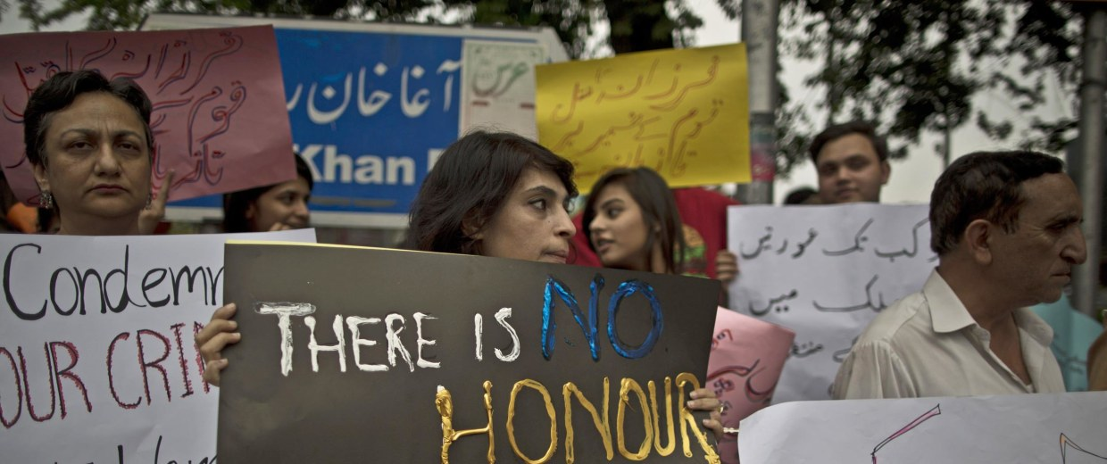 Image: Protesters hold banners condemning the killing of Farzana Iqbal