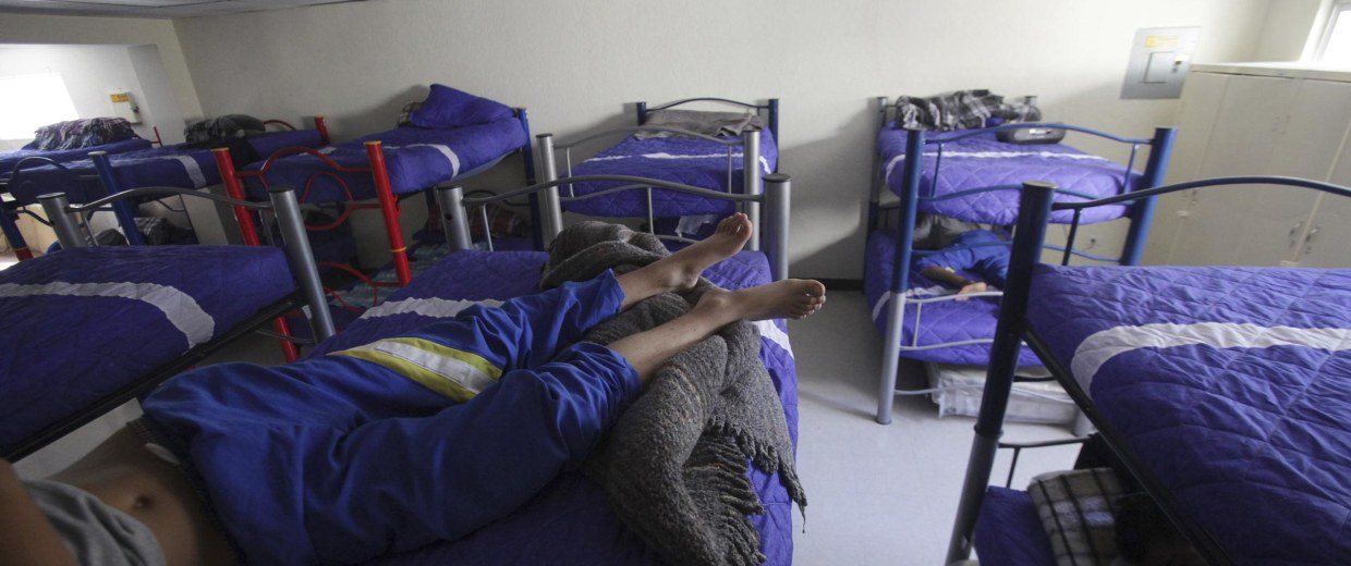 "Image: Boys lie down as they rest in bunk beds at the shelter for underage immigrants and repatriated minors ""Mexico, my home"" in Ciudad Juarez"