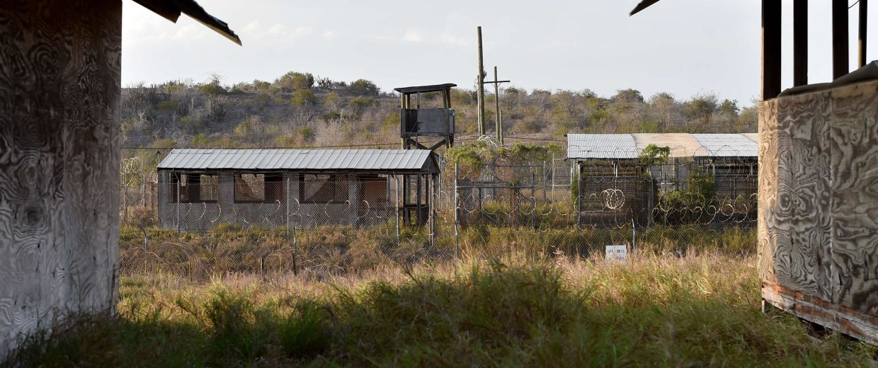"Image: The razor wire-topped fence and a watch tower at the abandoned ""Camp X-Ray"" detention facility at the US Naval Station in Guantanamo Bay, Cuba on April 9"