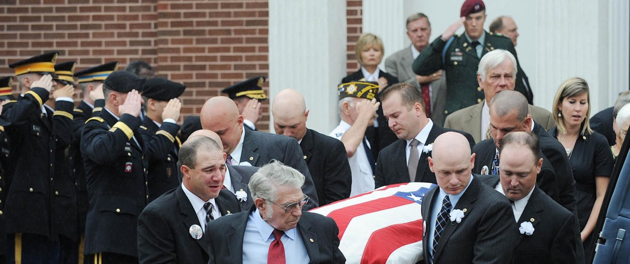 Image: Pallbears carry the  casket of 34-year-old 2nd Lt Darryn Andrews from the First Baptist church in Cameron, Texas on Sept. 12, 2009