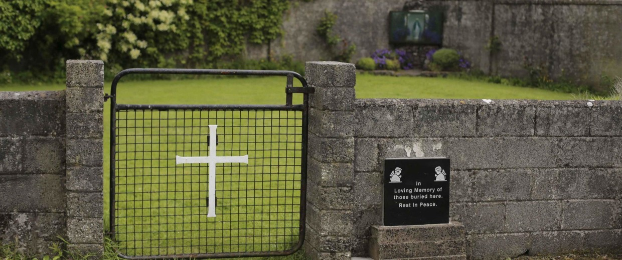 Image: The entrance to the site of a mass grave of hundreds of children who died in the former Bons Secours home for unmarried mothers is seen in Tuam, County Galway
