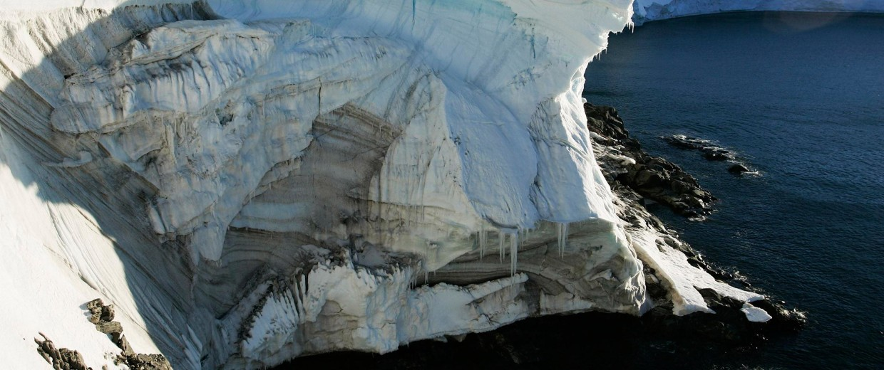 Image: Melting ice shows through at a cliff face at Landsend, on the coast of Cape Denison in Antarctica, in 2010.