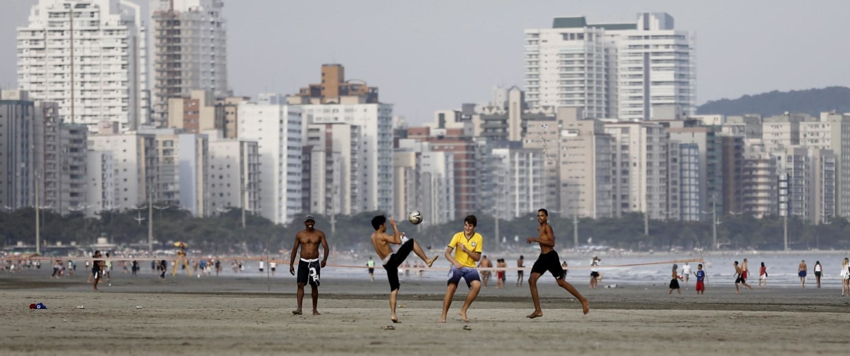Image: Brazilian teenagers play soccer at a beach in Guaruja near Sao Paulo