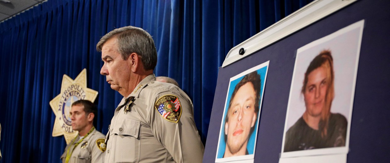 Image: Las Vegas Sheriff Doug Gillespie stands by a board with the pictures of suspects Jerad Miller and Amanda Miller during a news conference