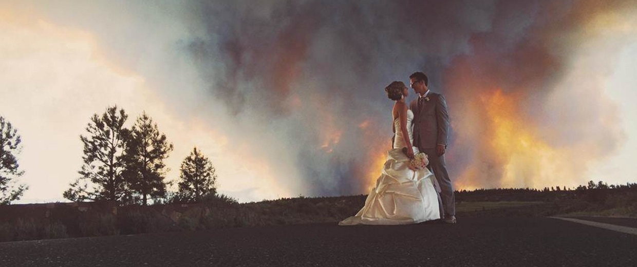 Image: In this Saturday, June 7, 2014 photo provided by Josh Newton, newlyweds Michael Wolber and April Hartley pose for a picture near Bend, Ore