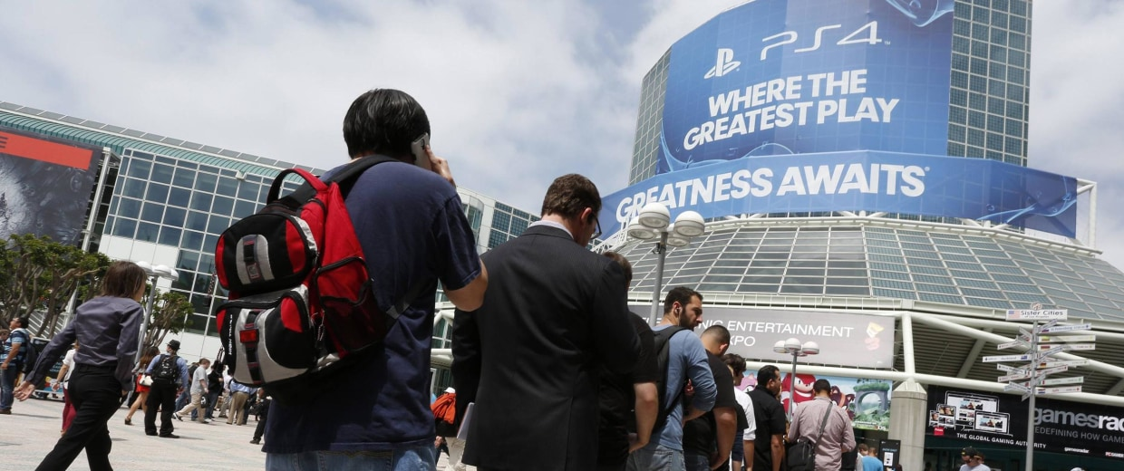 Image: People stand in line to enter the 2014 Electronic Entertainment Expo, known as E3, in Los Angeles