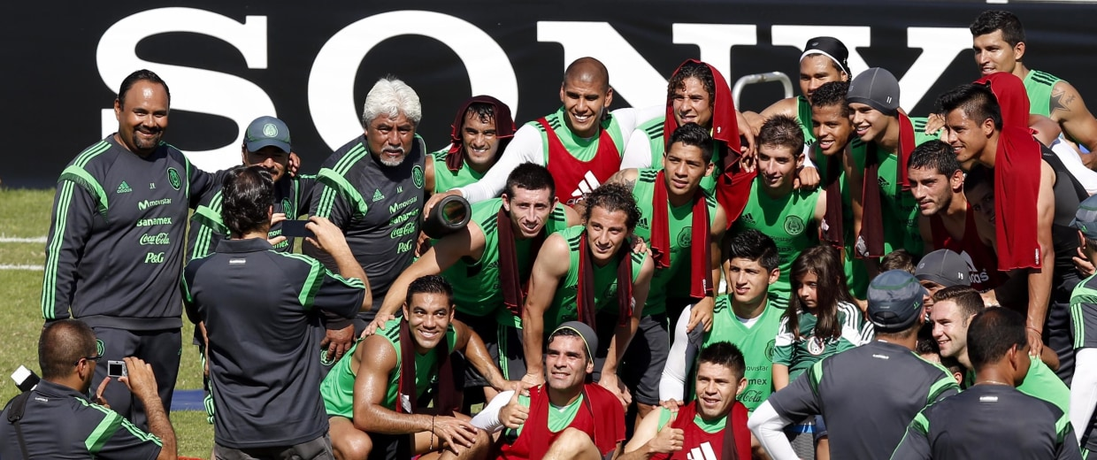 Image: Mexico's national soccer team pose for a photograph after their training session in Santos