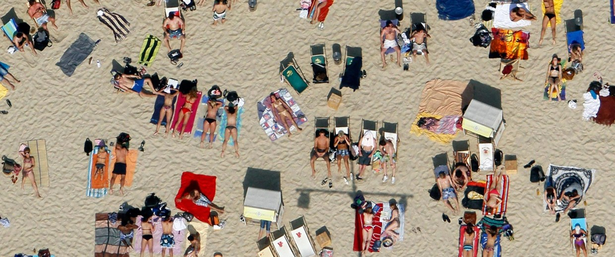 "Image: Sunbathers lay in the sun at the ""Uferlos"" swimming pool"