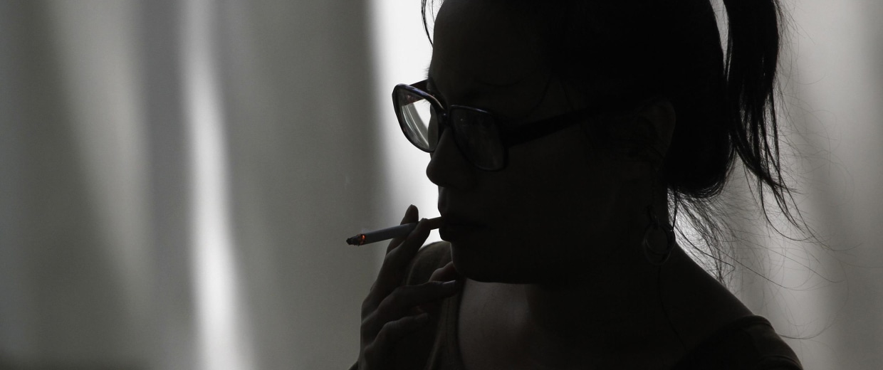 Image: A woman smokes a cigarette in Los Angeles, Calif. on May 31, 2012.