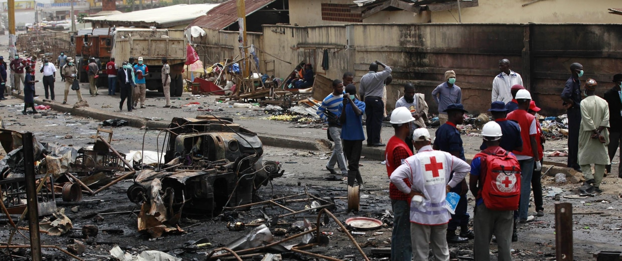 Image: People gather at the site of one of Tuesday's car bombs in Jos, Nigeria, May 21