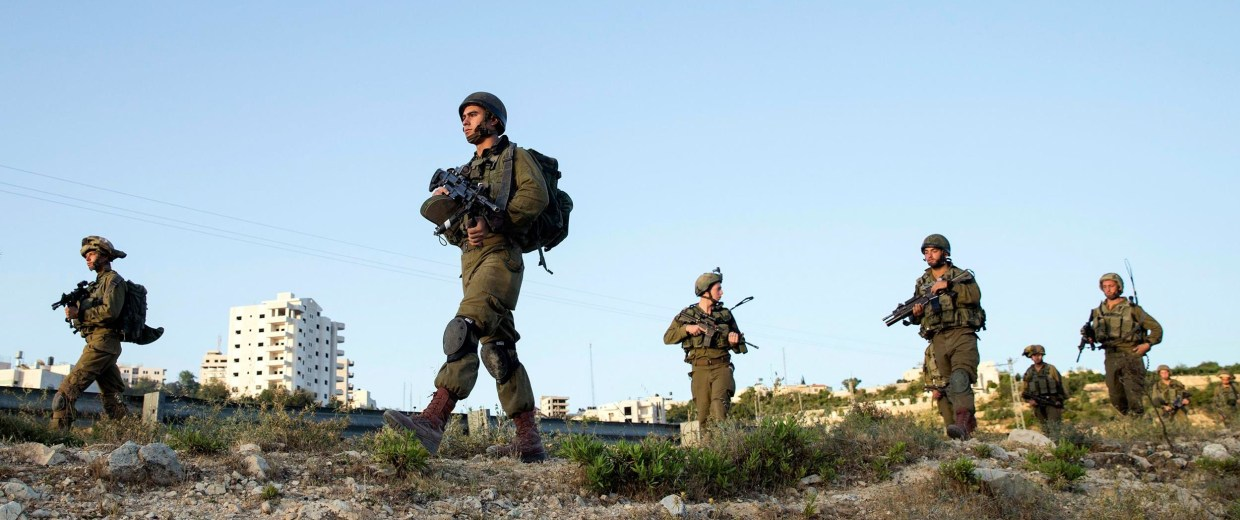 Image: Israeli soldiers take part in an operation to locate three Israeli teens near Hebron