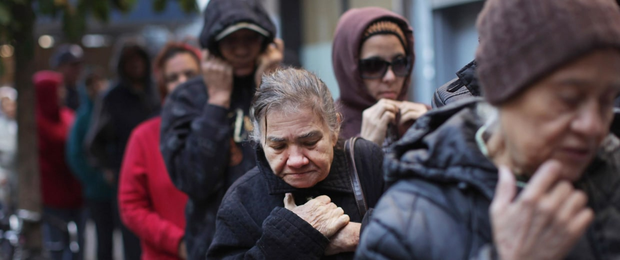 Image: People wait in line to receive free milk from the Milk from the Heart program on Oct. 6, 2011 in New York City..