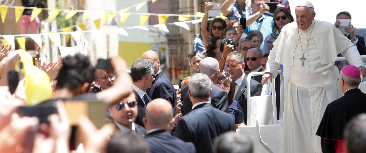 Image: Pope Francis, flanked by the president of CEI (Italian Episcopal Conference) Msgr Nunzio Galantino waves to the faithful as he arrives at the Cassano's Seminary on June 21 in Cassano allo Jonio Cosenza, Italy.