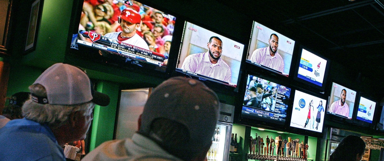 Image: LeBron James announces he will join the Miami Heat during a televised interview as fans look on at Duffy's on July 8, 2010 in Boca Raton, Fl.
