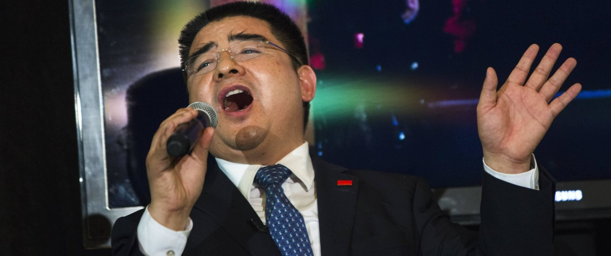 "Image: Chinese millionaire Chen Guangbiao sings ""We Are the World"" during a lunch he sponsored for hundreds of needy New Yorkers at Loeb Boathouse in New York's Central Park"