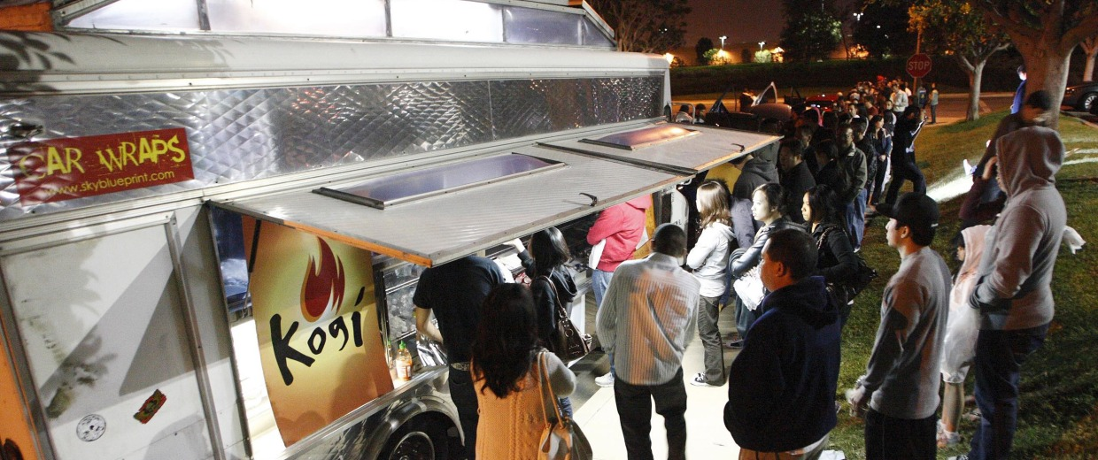 Image: People wait for their food as others line up to place their orders at Kogi, a Korean BBQ-inspired taco truck, in Torrance