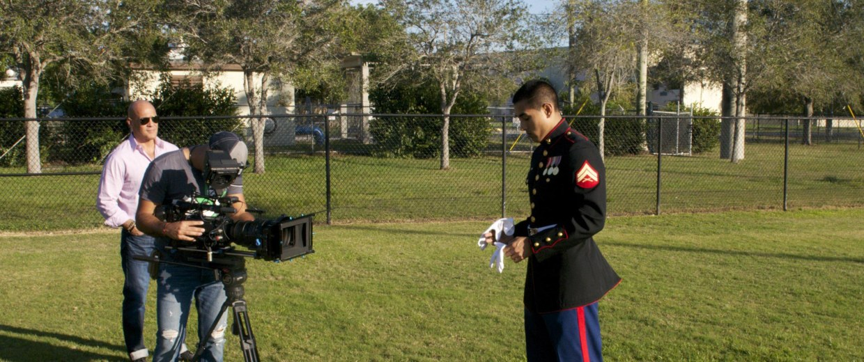 Image: Iraq War veteran Ernesto Mendoza discusses the difficulties he faced upon returning from war with Tony Hernandez, of the Immigrant Archive Project.