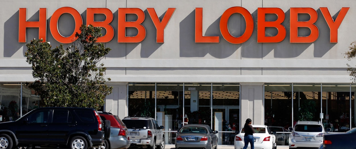 Image: Customers walk to a Hobby Lobby store in Dallas