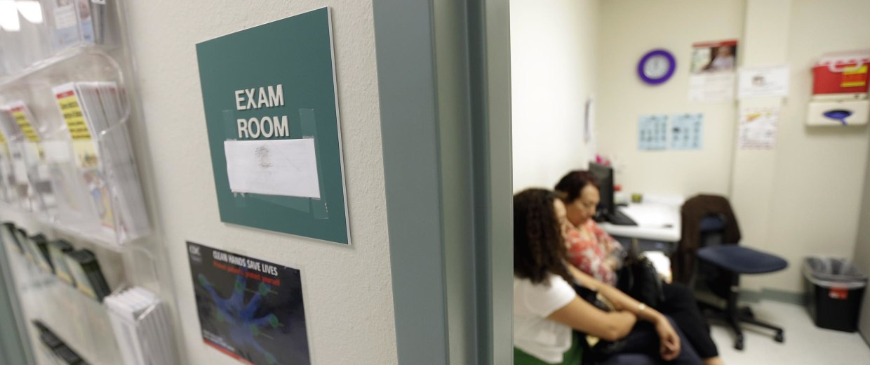 Image: Two women wait in an exam room at Nuestra Clinica Del Valle, in San Juan, Texas on July 12, 2012.