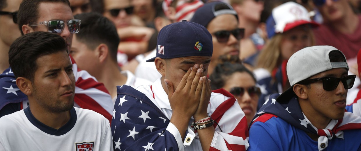 Image: USA fans react during the 2014 World Cup round of 16 soccer match between Belgium and the U.S. at a viewing party in Redondo Beach