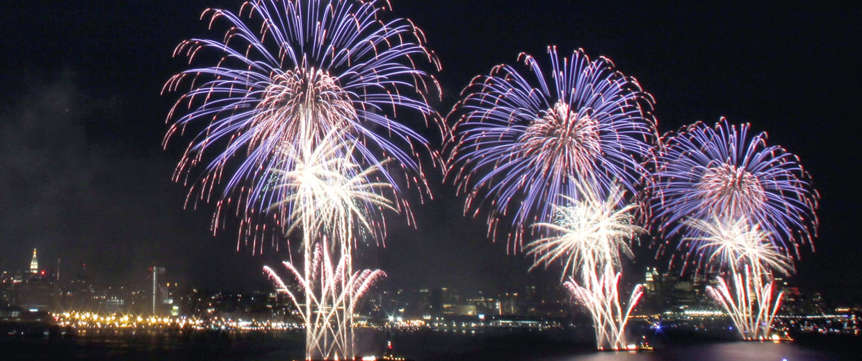 Image: The moon rises as fireworks explode over the Hudson River