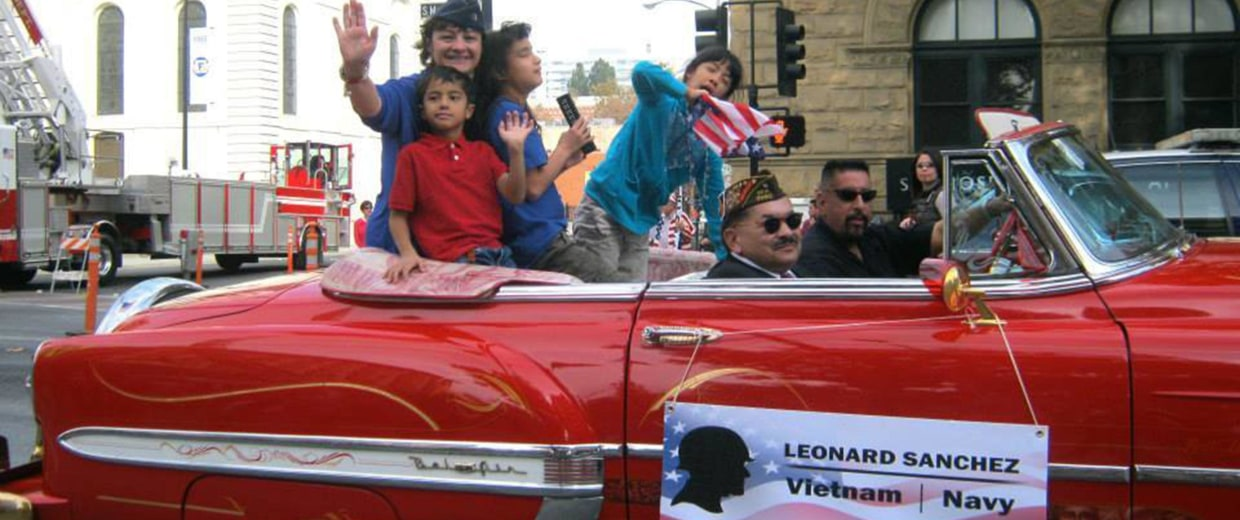 Image: Tiscareño-Sato and her children in a parade, Fall 2013.