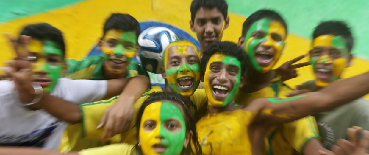 Image: Brazil fans gets their body painted