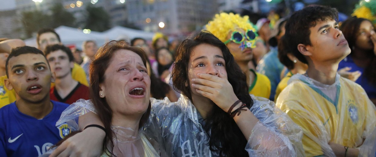 Image: Brazil soccer fans cry as they watch their team lose 7-1 to Germany