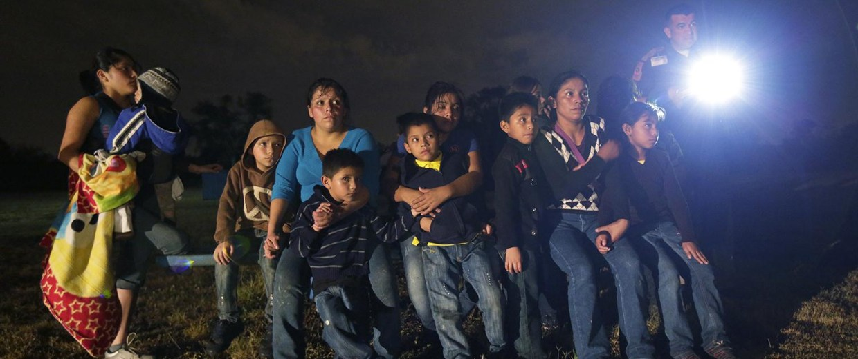 Image: A group of immigrants from Honduras and El Salvador who crossed the U.S.-Mexico border illegally are stopped in Granjeno, Texas