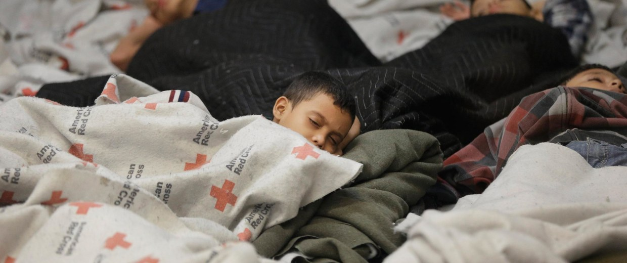 Image: Detainees sleep in a holding cell at a U.S. Customs and Border Protection processing facility, in Brownsville